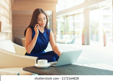 Successful businessman working at laptop.