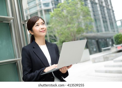 Successful businessman working at laptop