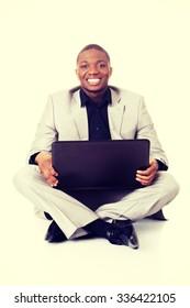 Successful businessman working on laptop.