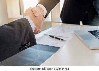 Successful businessmen handshaking after good deal. Business handshake and business people.