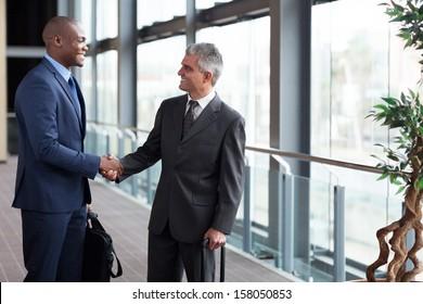 successful businessmen meeting at airport