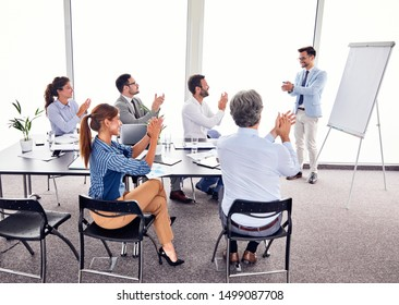 Successful businesspeople applauding and  having a meeting in an office. Business concept