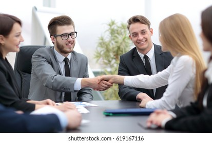 Successful  businesspeople shaking hands in a modern office
