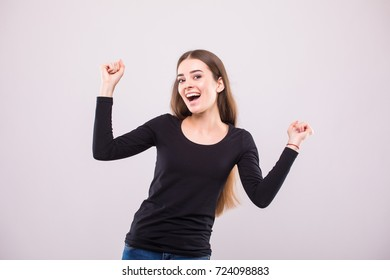 Successful businesswoman with arms up - isolated over a white