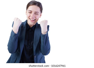 Successful businesswoman celebrates with her arms up in victory, isolated on white.