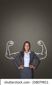 Successful businesswoman flexing her muscles in a conceptual image of power, management and leadership with hand-drawn flexed muscular arms of a body builder behind a an attractive professional woman