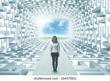 Successful businesswoman in front of a complicated labyrinth