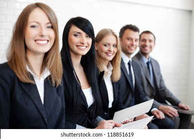 Successful businesswoman in group of business people