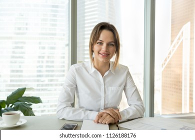 Successful businesswoman looking at camera recording video blog or vlog in office, confident business coach speaker talking for video call, webinar, job interview, online training, headshot portrait