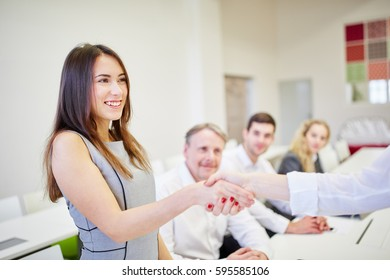 Successful businesswoman shaking hands after a negotiation