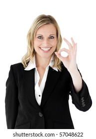 Successful businesswoman showing OK sign against a white background