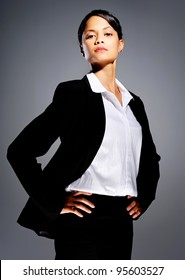 Successful businesswoman in suit with her hands on her hips