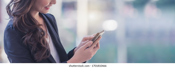 Successful businesswoman using smart phone, banner with space for text.