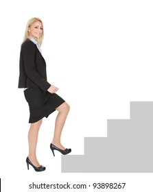 Successful businesswoman walking up a staircase. Isolated on white