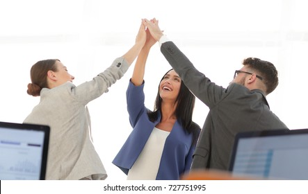 Successful businesswomen motivate each other with High Five