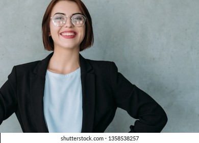 Successful career. Portrait of cheerful young business lady. Professional achievements. Personal development. Corporate growth.