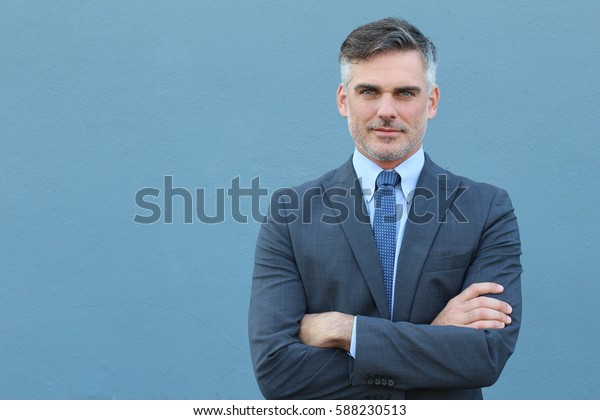 Successful Caucasian elegant businessman isolated with arms crossed