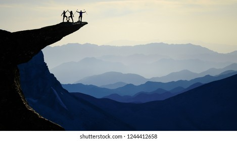 successful climbers on the summits of high mountains