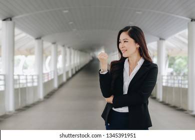Successful and confident asian senior businesswoman leader stand