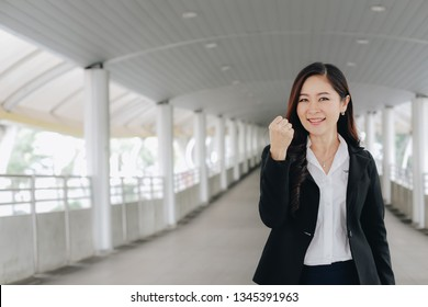 Successful and confident asian senior businesswoman leader standing over modern pathway background