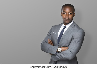 Successful confident black business man isolated with arms folded looking strong