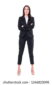 Successful confident business woman manager standing straight with crossed arms looking at camera. Full body isolated on white background.