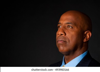 Successful confident businessman isolated on black.