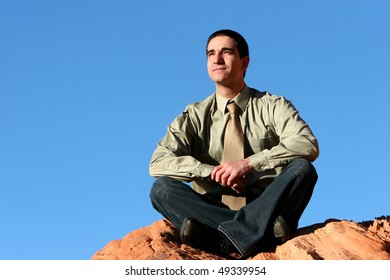 Successful confident businessman posing outdoors