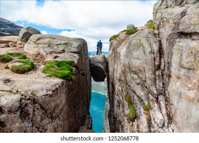 successful couple and spectacular views on risky rocks