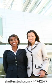 A successful, diverse business women  team at office building
