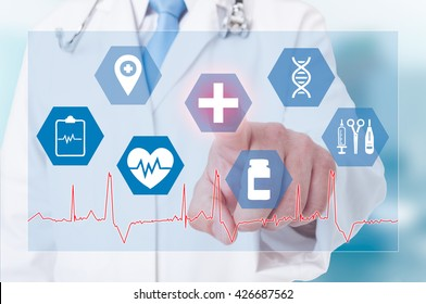 Successful doctor working with modern medical and healthcare type of icons on a touchscreen