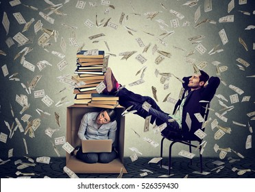Successful educated man boss making money relaxing under cash rain in his office with woman employee secretary working on computer inside box