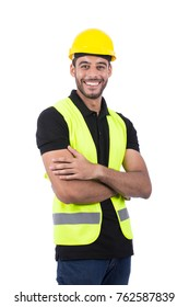 successful engineer wearing vest and yellow helmet with folded arms, isolated on white background.