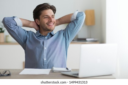 Successful Entrepreneur. Young Business Man Relaxing Sitting At Laptop Computer In Office.