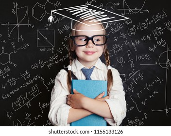 Successful female career concept. Cheerful little girl math student in graduation hat on school blackboard background with hand drawings science formula pattern