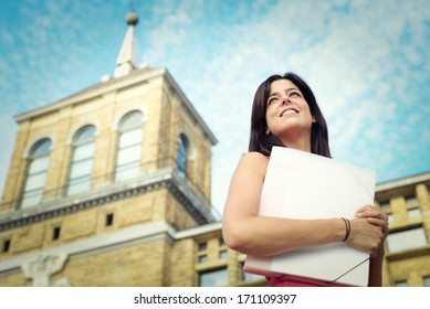 Successful female college student portrait in university campus. Education success and future opportunities concept.