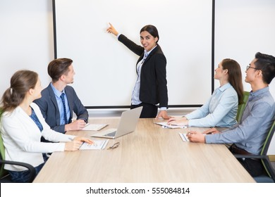 Successful female leader having meeting with team