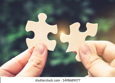 Successful female partnership with puzzle jigsaw women hands Teamwork support build dream team. Join Green tree power help safe solve environmental problem together in social network business