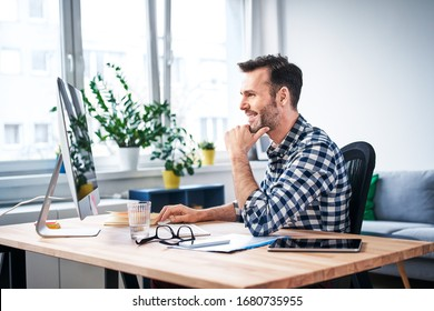 Successful freelancer working on computer while staying at home