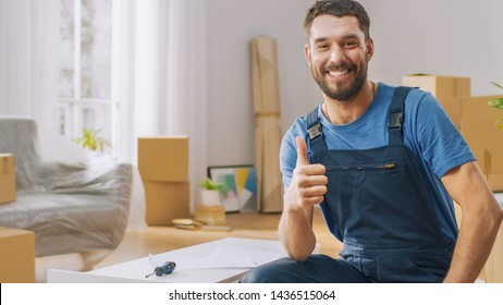 Successful Furniture Assembly Worker Finishes Assembling Shelf and Shows Thumbs Up Smilingly. Professional Handyman Doing Assembly Job Well, Helping People who Move into New House.