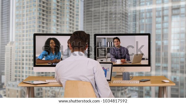 Successful group of business associates having internet based web conference over video chat