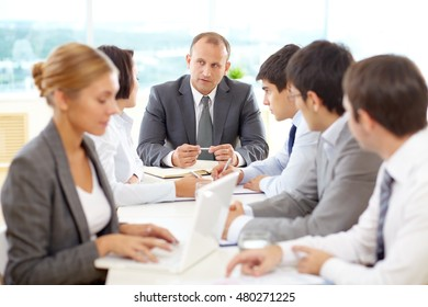 Successful group of business people having a meeting