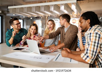 Successful group of designers, business people at work in office