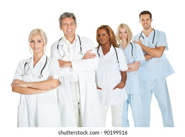 Successful group of doctors standing together isolated on white background