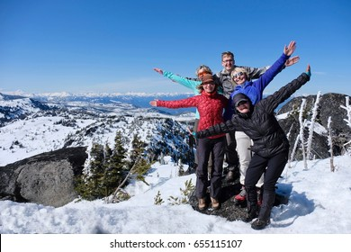 Successful group of friends on mountain top. Cascade Mountains summit. Icicle Ridge trail near Seattle and Leavenworth. Washington. United States.