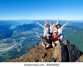Successful Group of Happy Friends on Mountain Top, Cheering.  Mount Cheam Summit,  British Columbia, Canada.