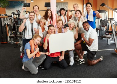 Successful group of people advertising something for a fitness center with a blank sign