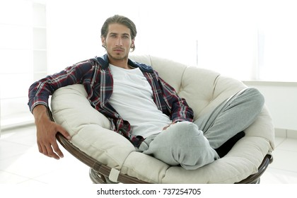 successful guy resting in modern living room.