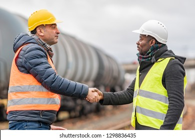 Successful handshake deal: multi-ethnic engineers reaching an agreement on construction site