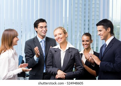 Successful happy businesswoman and businessteam at office. Success in business, partnership and teamwork theme concept.